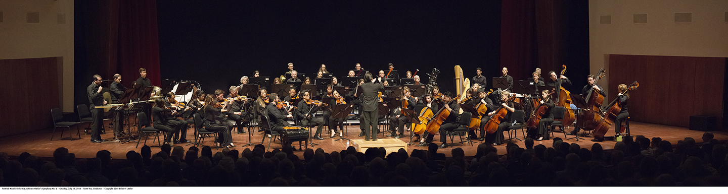 This is a panoramic photo of the orchestra performing Mahler at the Performing Arts Center on the Cal Poly campus.